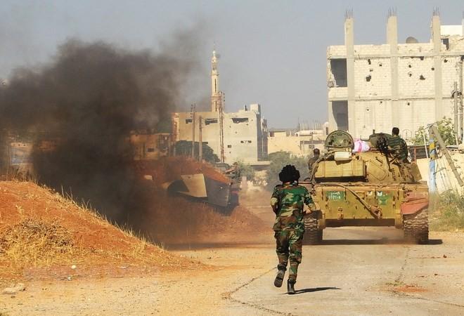 Tentara Suriah memperkuat operasi pembersihan membasmi para militan IS - ảnh 1