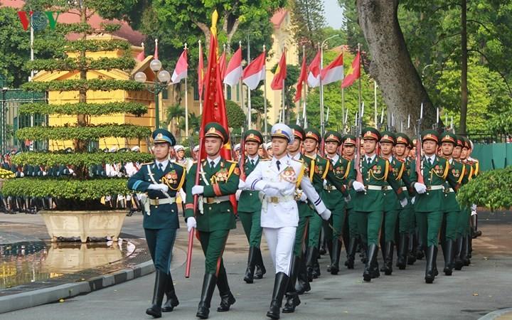 Panorama kunjungan Kenegaraan Presiden Indonesia, Joko Widodo di Viet Nam - ảnh 1