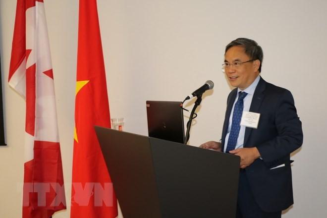 """Simposium """"Kesempatan-kesempatan dagang dan investasi yang baru di Viet Nam"""" yang diselenggarakan di Kanada - ảnh 1"""
