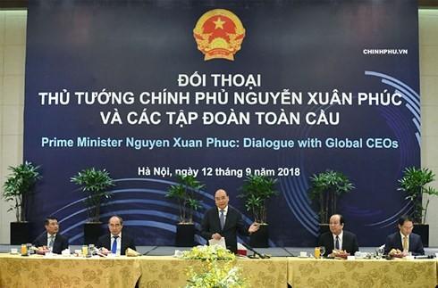 PM Nguyen Xuan Phuc menyambut komitmen dari semua Grup global dalam melakukan bisnis jangka panjang di Viet Nam tahun 2018 - ảnh 1