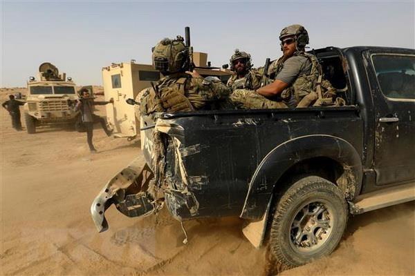 Pasukan koalisi yang dikepalai oleh AS di Irak ditempatkan dalam situasi siaga bertempur - ảnh 1