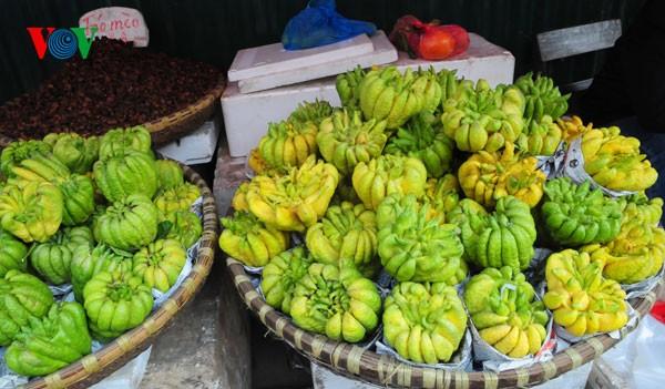Пять видов фруктов, поставленных на алтаре во время Новогоднего праздника - ảnh 2