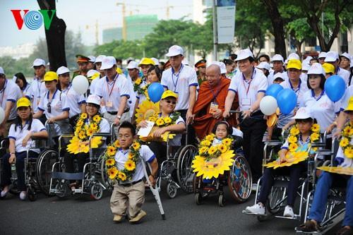 Президент СРВ Чыонг Тан Шанг принял участие в марше за детей-инвалидов - ảnh 2