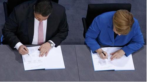 В Германии ХДС/ХСС и СДПГ подписали договор о создании коалиционного правительства - ảnh 1