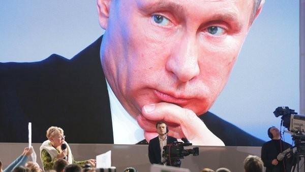 Владимир Путин председательствовал на ежегодной пресс-конференции в Москве - ảnh 1