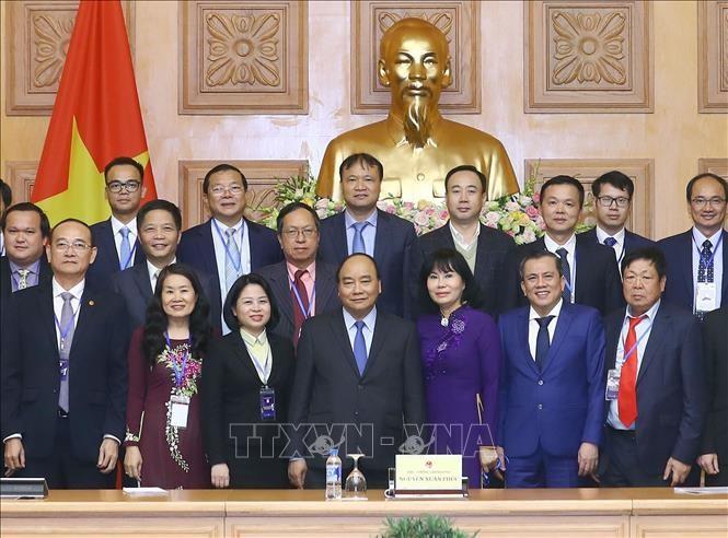 Нгуен Суан Фук принял руководителей предприятий, удостоенных звания «Национальный бренд» - ảnh 1