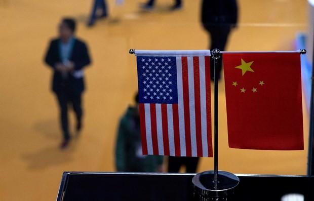 """Дональд Трамп пригрозил ввести повышенные пошлины на китайские товары, Пекин выразил готовность """"бороться до конца"""" - ảnh 1"""