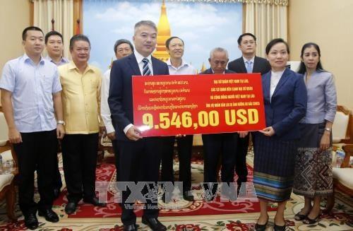 Cộng đồng người Việt quyên góp ủng hộ người dân Lào gặp thiên tai - ảnh 1