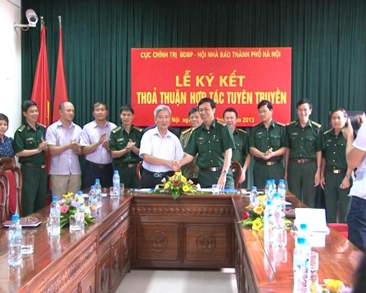 Menandatangani permufakatan kerjasama penyosialisasian tentang perbatasan, laut dan pulau - ảnh 1