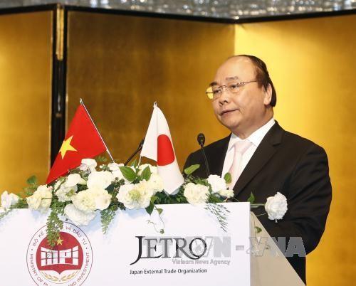 PM Nguyen Xuan Phuc menghadiri Konferensi  promosi investasi Vietnam di Jepang - ảnh 1