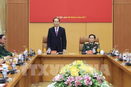 Presiden Tran Dai Quang melakukan temu kerja dengan pemimpin Kemhan Vietnam - ảnh 1
