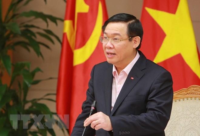 Deputi PM Vuong Dinh Hue memimpin Sidang triwulan I/2018 Dewan konsultasi kebijakan moneter  - ảnh 1