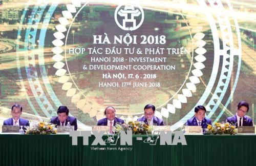 """PM Nguyen Xuan Phuc menghadiri Konferensi """"Hanoi 2018- Kerjasama Investasi dan Perkembangan"""" - ảnh 1"""