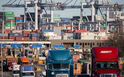 AS resmi mengenakan tarif terhadap barang impor dari Tiongkok senilai 34 miliar USD - ảnh 1