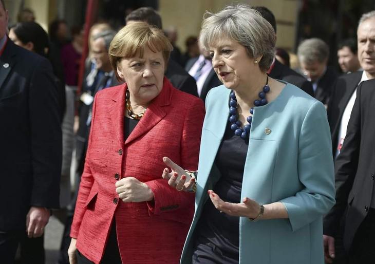 PM Inggris mendapat dukungan dari kabinet baru dan Kanselir Jerman. - ảnh 1