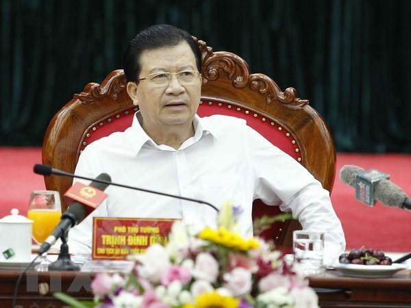 Deputi PM Trinh Dinh Dung : Mencegah dan memberantas semua manifestasi yang subyektif dalam menghadapi musibah dan bencana alam - ảnh 1