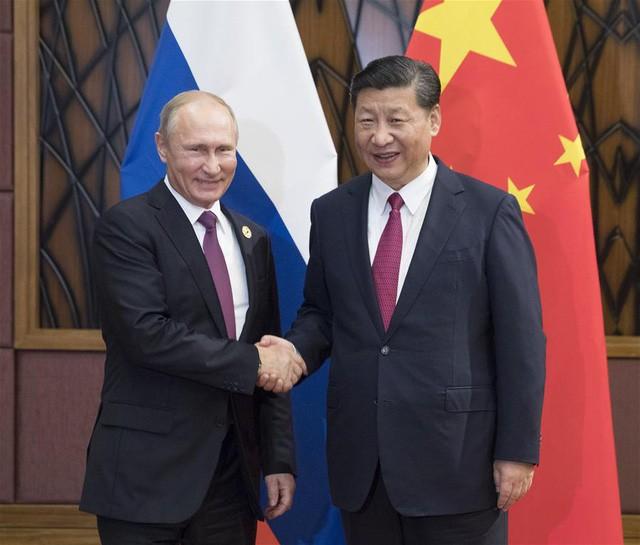 Pemimpin negara-negara melakukan pembicaraan bilateral di sela-sela KTT BRICS - ảnh 1