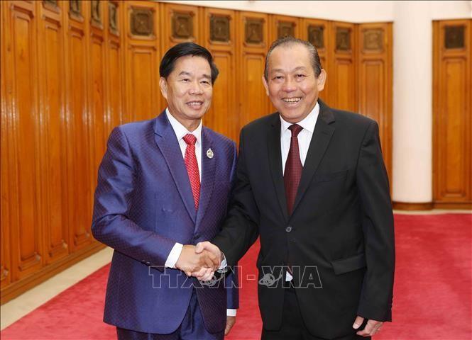 Deputi Harian PM Truong Hoa Binh menerima Sekretaris, Gubernur Ibukota Vientiane, Laos - ảnh 1