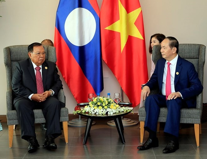 President meets Lao, Cambodian, Republic of Korean leaders  - ảnh 1