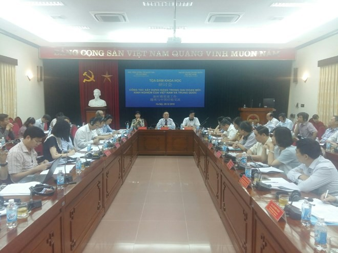 Seminar highlights Party building experiences of Vietnam, China - ảnh 1