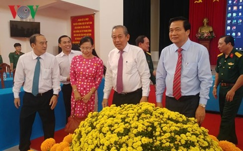 Leaders pay Tet visits to policy beneficiaries, poor people  - ảnh 1
