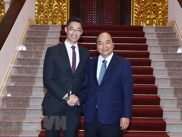 PM calls on economist Philipp Rosler to help Vietnam's startup development - ảnh 1