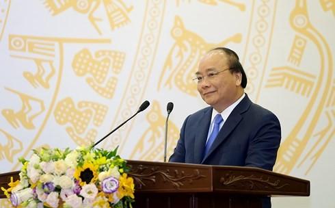 越南政府总理阮春福:新闻媒体为建设和保卫祖国事业做出巨大贡献 - ảnh 1
