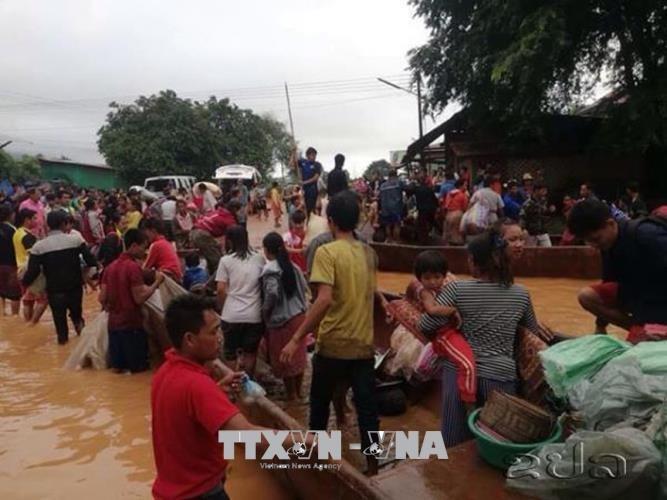 老挝政府通过对水电站溃坝事故受害者的赔偿政策 - ảnh 1