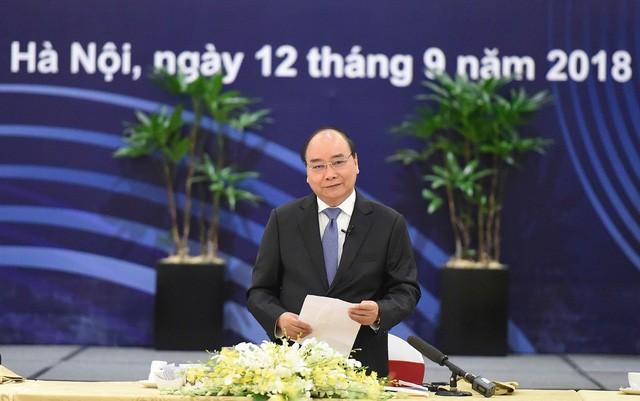 越南政府总理阮春福对世界大型集团承诺在越长期经营表示欢迎 - ảnh 1
