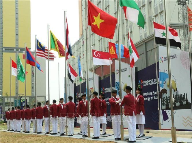 Церемония поднятия флага вьетнамской сборной на Азиатских Паралимпийских играх 2018 - ảnh 1