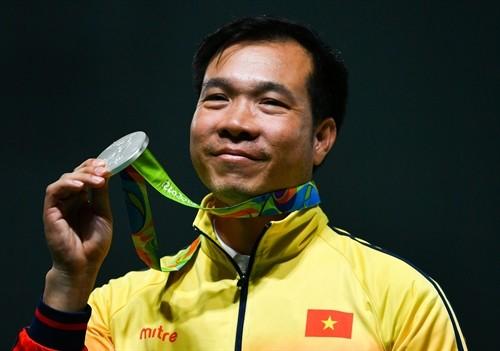Hoang Xuan Vinh among top 10 medalists at 2016 Rio Olympics  - ảnh 1