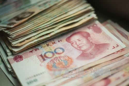 China's yuan hits 6-year low record - ảnh 1