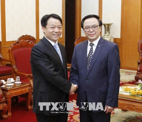 Trưởng ban Đối ngoại Trung ương Hoàng Bình Quân tiếp đoàn đại biểu TW Đoàn TNCS Trung Quốc - ảnh 1
