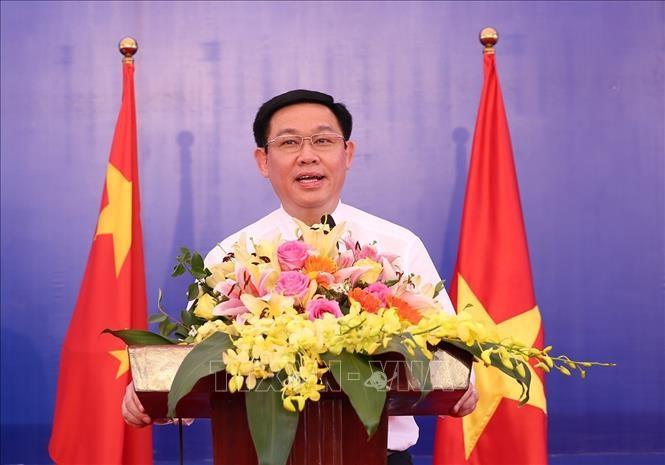 Phó Thủ tướng Chính phủ Vương Đình Huệ hội đàm với Phó Thủ tướng Quốc Vụ viện Trung Quốc - ảnh 1