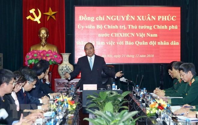 Thủ tướng Nguyễn Xuân Phúc thăm và làm việc với Báo Quân đội nhân dân - ảnh 1