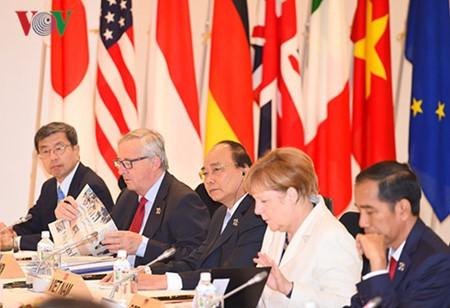 Finaliza el primer ministro vietnamita su visita a Japón y asistencia a la Cumbre ampliada del G7 - ảnh 1