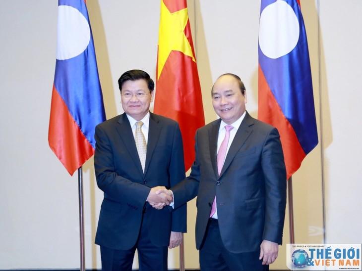 Vietnam-Laos determinados a elevar el grado de relaciones bilaterales  - ảnh 1