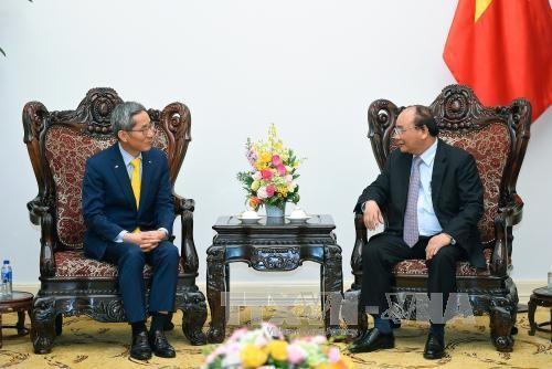 Primer ministro vietnamita recibe al presidente de corporación financiera surcoreana - ảnh 1