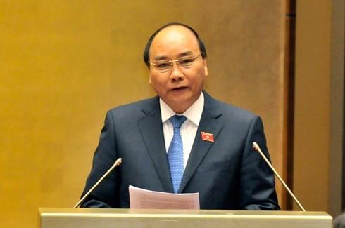 El jefe de Gobierno vietnamita rinde cuentas ante el Parlamento - ảnh 1