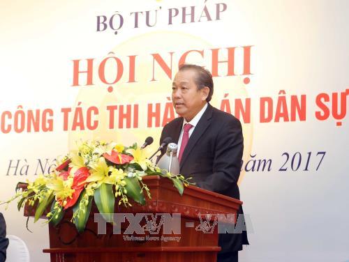 Llaman al sector de justicia de Vietnam a elevar la calidad de la ejecución civil - ảnh 1