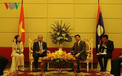 Vietnam y Laos acuerdan impulsar la implementación de los acuerdos sellados - ảnh 1