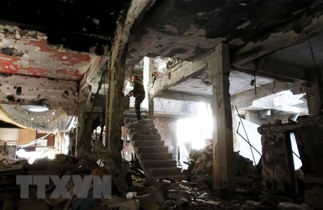 Fuerzas gubernamentales sirias vencen a los yihadistas en el sur de Damasco - ảnh 1