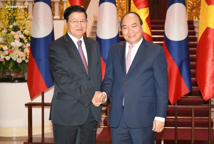 Líder partidista vietnamita se reúne con el primer ministro laosiano  - ảnh 1
