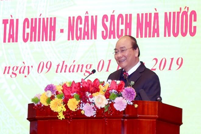 Premier vietnamita pide diseñar mecanismos a favor de pequeñas y medinas empresas - ảnh 1