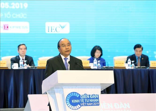 Premier vietnamita resalta posición de las empresas privadas en la economía nacional - ảnh 1