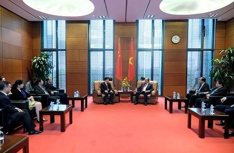 นายกรัฐมนตรีให้การต้อนรับประธานกลุ่มบริษัท Sunwah ของฮ่องกง ประเทศจีน - ảnh 3