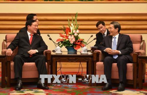 นายเหงียนหว่าบิ่งห์ หัวหน้าศาลประชาชนสูงสุดเยือนประเทศจีน - ảnh 1