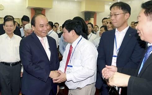 นายกรัฐมนตรีเหงียนซวนฟุ๊กเข้าร่วมการประชุมส่งเสริมการลงทุนจังหวัดบิ่งเฟือก  - ảnh 1