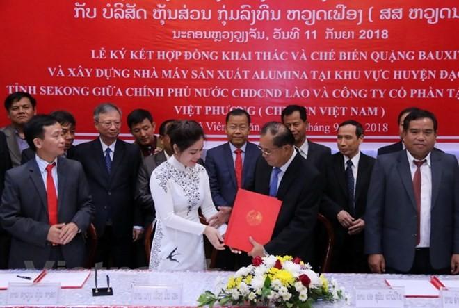 เวียดนามปฏิบัติโครงการขุดเจาะเหมืองแร่ใหญ่ที่สุดในประเทศลาว - ảnh 1
