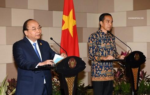 เวียดนามและอินโดนีเซียเห็นพ้องสร้างก้าวกระโดดใหม่ในความสัมพันธ์ทวิภาคี - ảnh 1